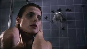 Spiders and bugs coming out of a shower faucet.