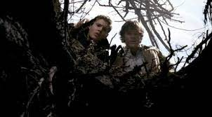 Sam and Dean Winchester looking down a hole.